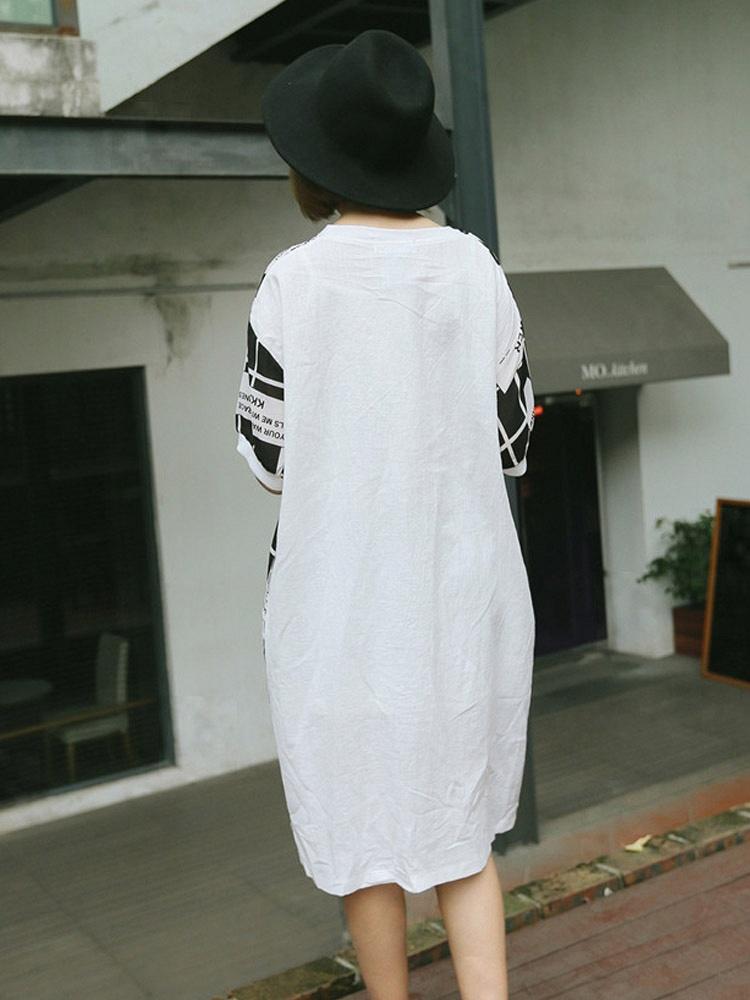 kodan 报纸图案连衣裙 衣服舒适柔软,做工很精细